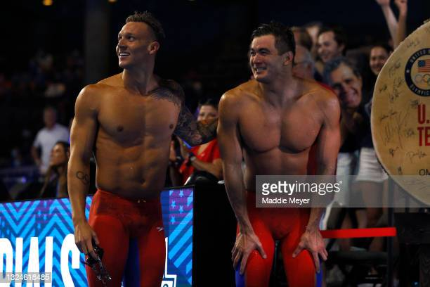 Caeleb Dressel and Nathan Adrian of the United States react after competing in the Men's 50m freestyle final during Day Eight of the 2021 U.S....