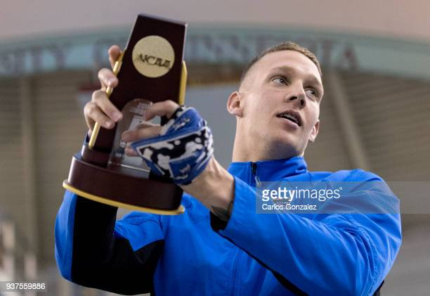 Caeleb Dressel of Florida held his trophy after winning the 100 yard freestyle during the Division I Men's Swimming Diving Championship held at the...