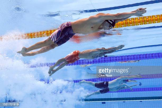 Caeleb Dressel of Team United States, Bruno Fratus of Team Brazil and Benjamin Proud of Team Great Britain compete in the Men's 50m Freestyle Final...