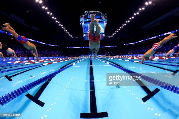 Caeleb Dressel of the United States competes in the Men's 50m freestyle final during Day Eight of the 2021 U.S. Olympic Team Swimming Trials at CHI...