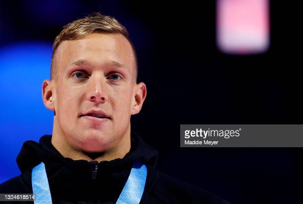 Caeleb Dressel reacts during the Men's 50m freestyle medal ceremony during Day Eight of the 2021 U.S. Olympic Team Swimming Trials at CHI Health...