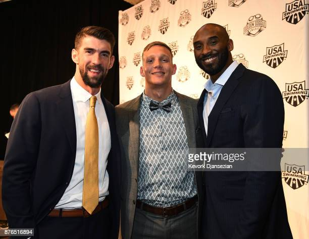 Caeleb Dressel winner of Male Athlete of the Year poses with Michael Phelps and Kobe Bryant during the 2017 USA Swimming Golden Goggle Awards at JW...