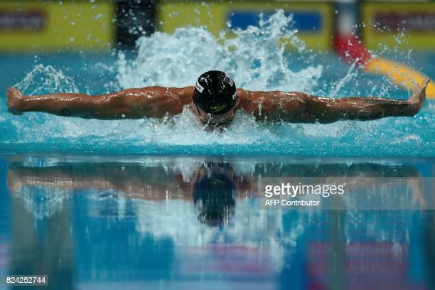 US Caeleb Remel Dressel competes in the men's 100m butterfly final during the swimming competition at the 2017 FINA World Championships in Budapest...