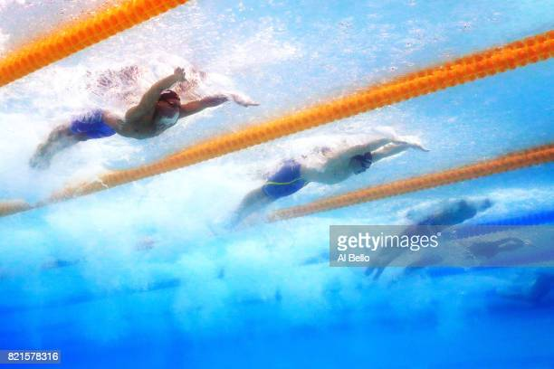 Caeleb Remel Dressel of the United States Andrii Govorov of Ukraine and Benjamin Proud of Great Britain competes during the Men's 50m Butterfly Final...