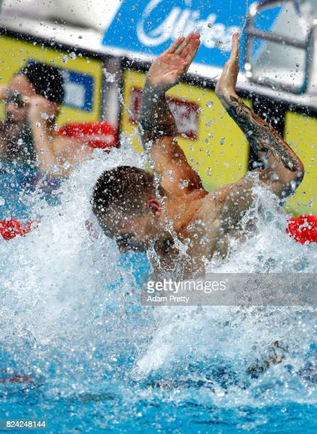 Caeleb Remel Dressel of the United States celebrates winning the gold medal during the Men's 100m Butterfly final on day sixteen of the Budapest 2017...