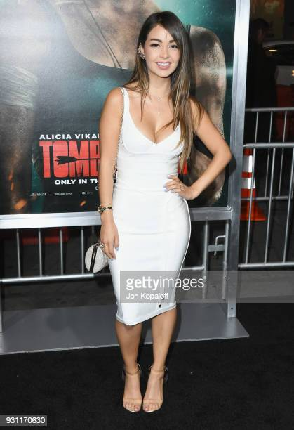 Caeli attends the Los Angeles Premiere 'Tomb Raider' at TCL Chinese Theatre IMAX on March 12 2018 in Hollywood California