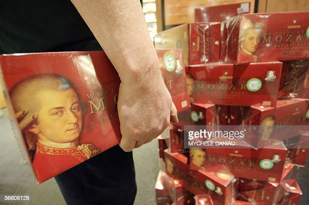 A person presents a box of Mozart's music CDs sold by the Dutch label Brillant Classics and containing 170 CDs 17 January 2006 in Caen western France...