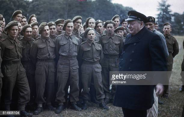 Caen, France: Prime Minister Winston Churchill speaks to some to troops who led the assault on D-Day. General Sir Bernard Montgomery is just visible...