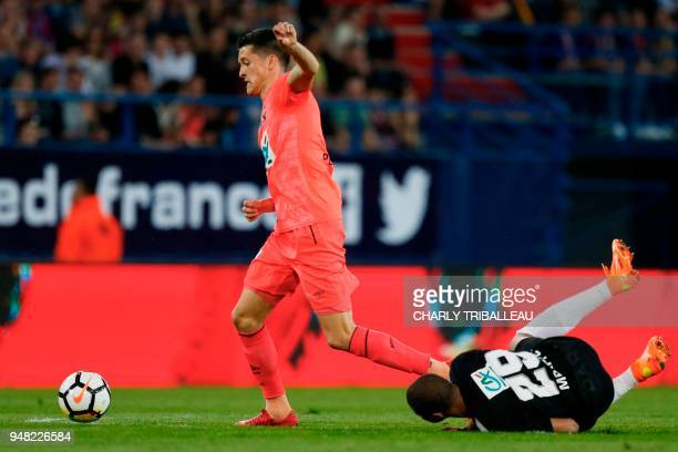 Caen's Belgian midfielder Stef Peeters outruns Paris SaintGermain's French forward Kylian Mbappe during the French cup semifinal match between Caen...