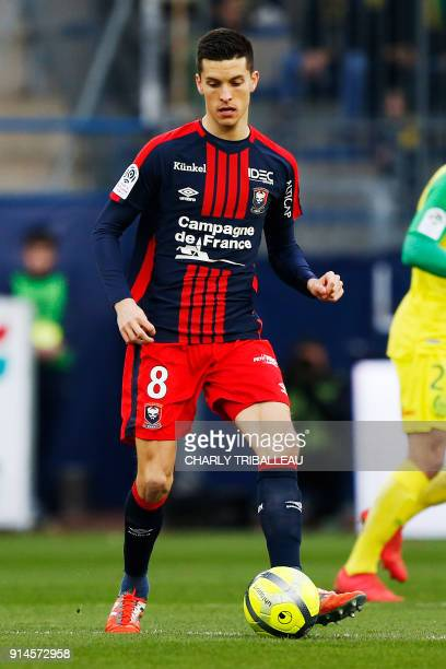 Caen's Belgian midfielder Stef Peeters runs with the ball during the French L1 football match between Caen and Nantes on February 4 at Michel...