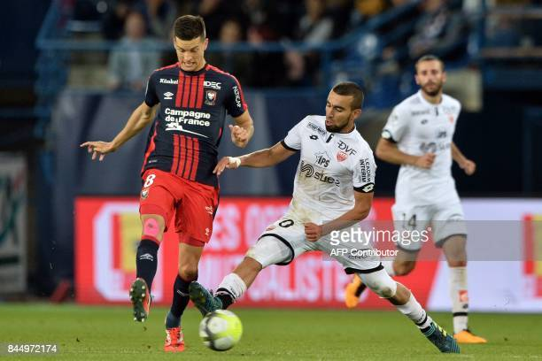 Caen's Belgian midfielder Stef Peeters vies with Dijon's Tunisian midfielder Naim Sliti during the French L1 football match between Caen and Dijon on...