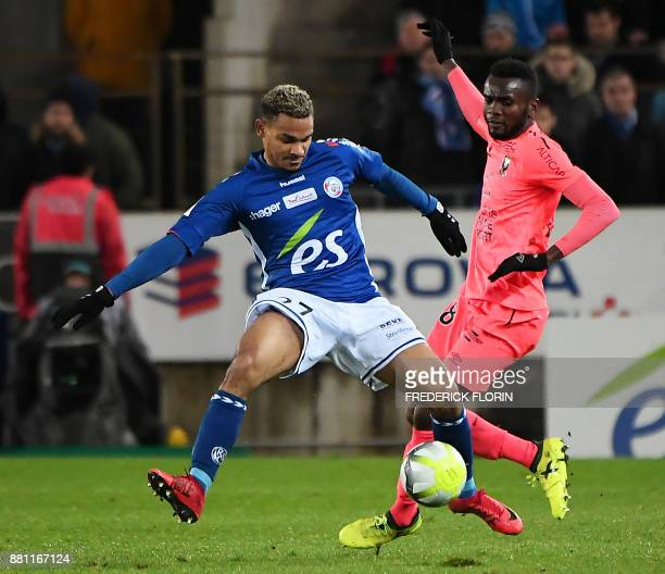 Caen's Belgian midfielder Stef Peeters vies with Strasbourg's French defender Kenny Lala during the French L1 football match between Strasbourg and...