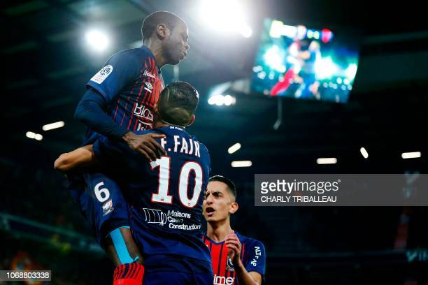Caen's Congolese midfielder Prince Oniangue celebrates with Caen's Moroccan midfielder Faycal Fajr after scoring during the French L1 football match...