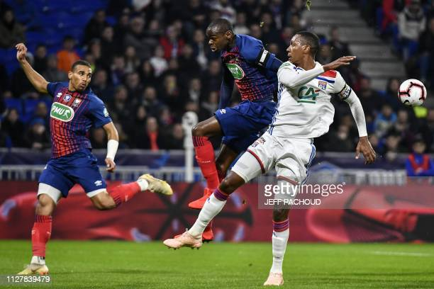 Caen's Congolese midfielder Prince Oniangue vies with Lyon's Brazilian defender Marcelo during the French Cup quarterfinal football match between...