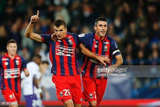 Caen's Croatian forward Ivan Santini celebrates with French midfielder Nicolas Seube celebrates after scoring a goal during the French L1 football...