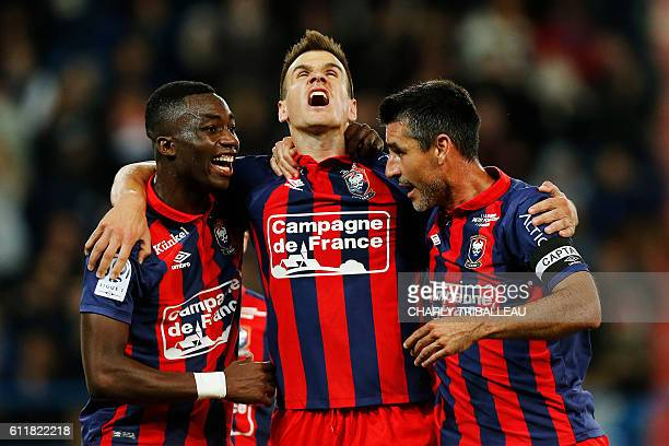 Caen's Croatian forward Ivan Santini celebrates with teammates after scoring a goal during the French L1 football match between Caen and Toulouse at...
