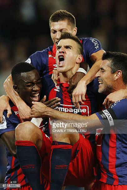 Caen's Croatian forward Ivan Santini celebrates with teammates after scoring during the French L1 football match between Caen and Toulouse , on...