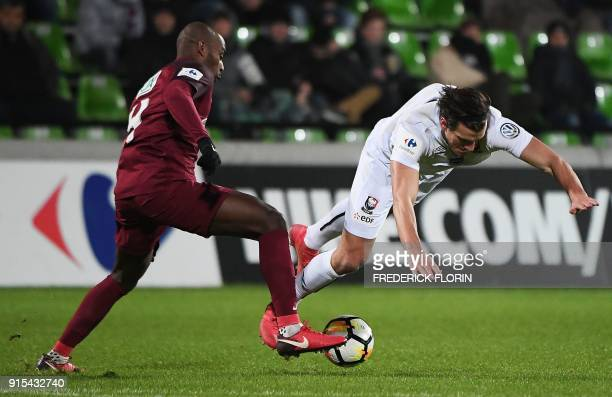 Caen's Croatian forward Ivan Santini vies with Metz's French defender Jonathan Rivierez during the French Cup football match between Metz and Caen on...