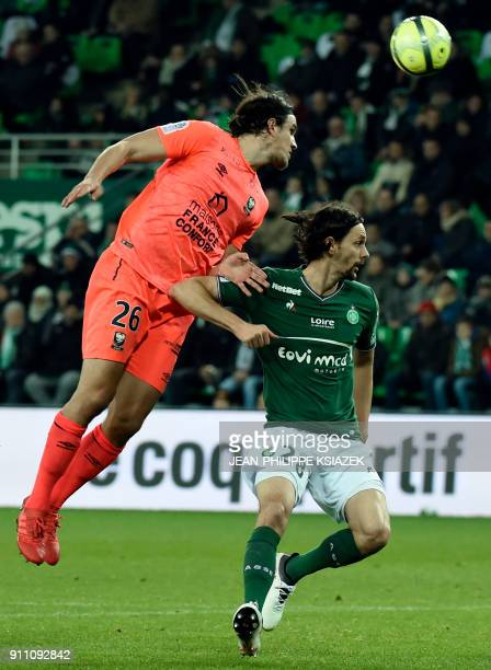 Caen's Croatian forward Ivan Santini vies with SaintEtienne's Slovenian defender Neven Subotic during the French L1 football match SaintEtienne vs...