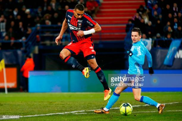 Caen's French defender Alexander Djiku vies for the ball with Olympique de Marseille's French midfielder Florian Thauvin during the French L1...
