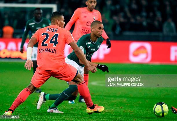 Caen's French defender Alexander Djiku vies with SaintEtienne's French forward Kevin MonnetPaquet during the French L1 football match between...