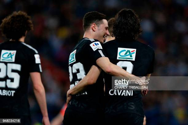Caen's French defender Damien Da Silva vies for the ball with Paris SaintGermain's French midfielder Adrien Rabiot during the French cup semifinal...