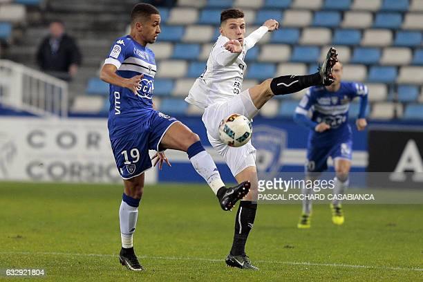 Caen's French defender Frederic Gilbert vies with Bastia's French midfielder Axel Ngando during the L1 football match between Bastia and Caen on...