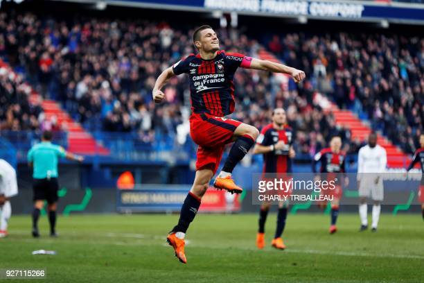 Caen's French defender Frederic Guilbert celebrates after scoring a goal during the French L1 football match between Caen and Strasbourg on March 4...