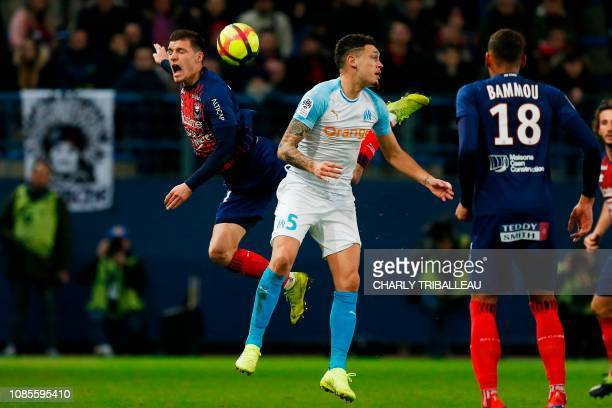 Caen's French defender Frederic Guilbert reacts as he vies for the ball with Olympique de Marseille's Argentinian forward Lucas Ocampos during the...