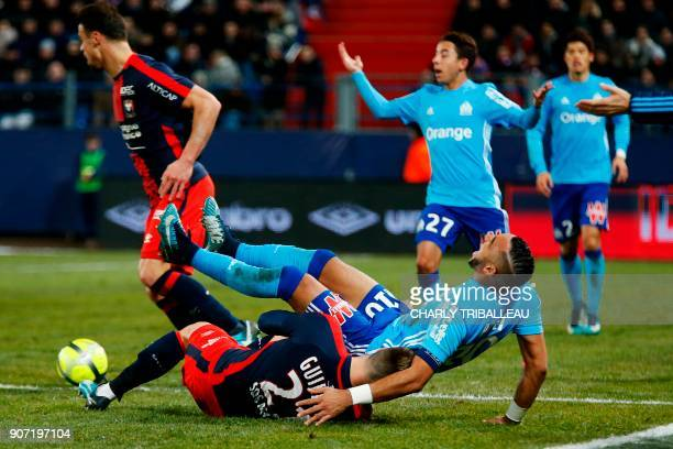 Caen's French defender Frederic Guilbert vies for the ball with Olympique de Marseille's French forward Dimitri Payet during the French L1 football...