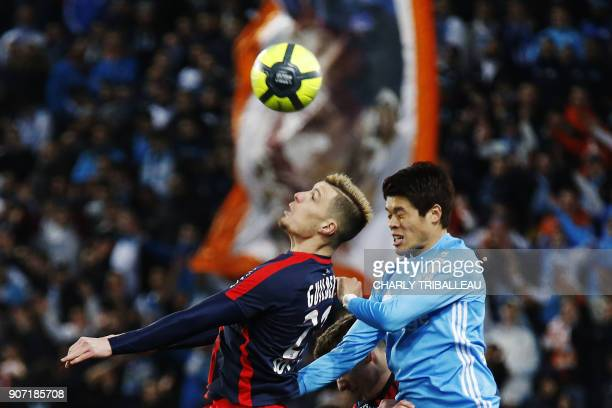 Caen's French defender Frederic Guilbert vies for the ball with Marseille's Japanese defender Hiroki Sakai during the French L1 football match...