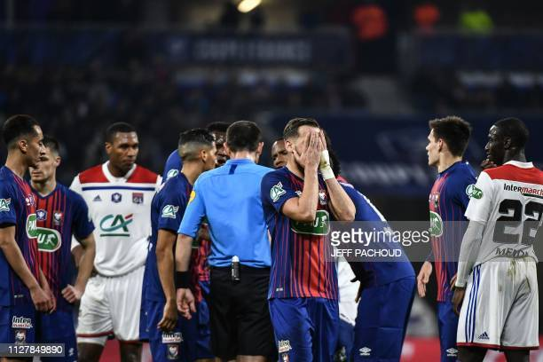 Caen's French defender Jonathan Gradit reacts as players argue with the referee during the French Cup quarterfinal football match between Olympique...
