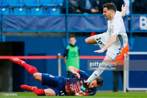 Caen's French defender Jonathan Gradit vies for the ball with Strasbourg's French midfielder Benjamin Corgnet during the French L1 football match...