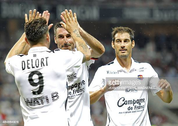 Caen's French forward Andy Delort is congratulated by teammates after scoring a goal during the French L1 football match Nice against Caen on August...
