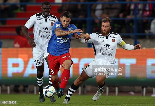 Caen's French forward Andy Delort vies with Ajaccio's French defender Roderic Filippi during the French L1 football match between Stade Malherbe de...