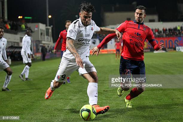 Caen's French forward Andy Delort vies with Ajaccio's French defender Pablo Martinez during the French L1 football match between Gazelec Ajaccio and...