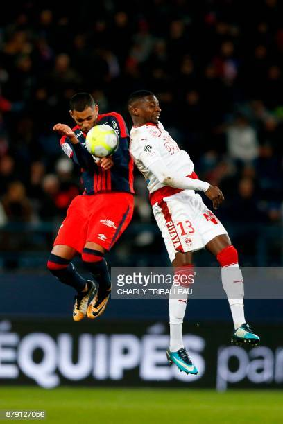Caen's French forward Sylvio Ronny Rodelin vies for the ball with Bordeaux's Senegalese midfielder Younousse Sankhare during the French L1 football...