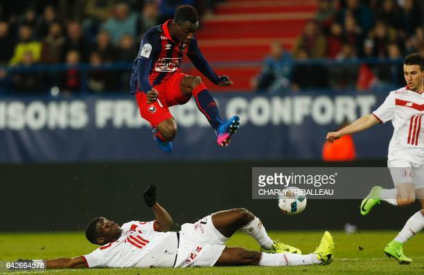 Caen's French forward Yann Karamoh jumps over Lille's French defender Adama Soumaoro as they fight for the ball during the French L1 football match...