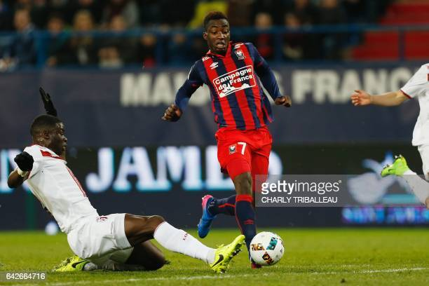 Caen's French forward Yann Karamoh runs with the ball as Lille's French defender Adama Soumaoro attempts to block him during the French L1 football...