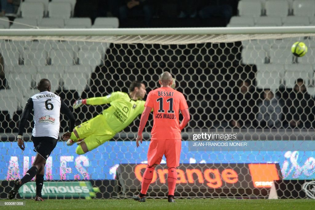 Caen's French goalkeeper Remy Vercoutre (C) is fails to save a goal during the French L1 Football match between Angers (SCO) and Caen (SMC), on March 17, 2018, in Raymond-Kopa Stadium, in Angers, northwestern France. MONIER