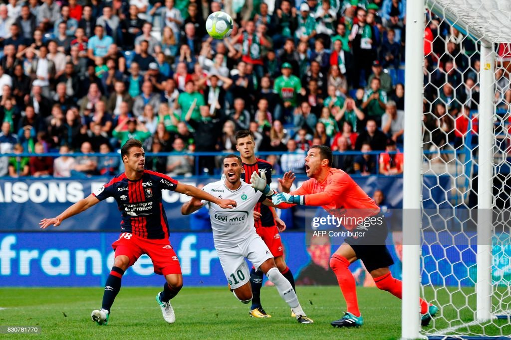 Caen's French goalkeeper Remy Vercoutre saves a ball in front of his teammate French defender Damien Da Silva and Saint-Etienne's French forward Oussama Tannane during the French L1 football match between Caen (SMC) and Saint-Etienne (ASSE) on August 12, 2017, at the Michel d'Ornano stadium, in Caen, northwestern France. /