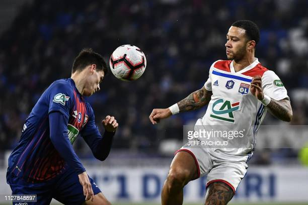 Caen's French midfielder Jessy Deminguet vies with Lyon's Dutch forward Memphis Depay during the French Cup quarterfinal football match between...