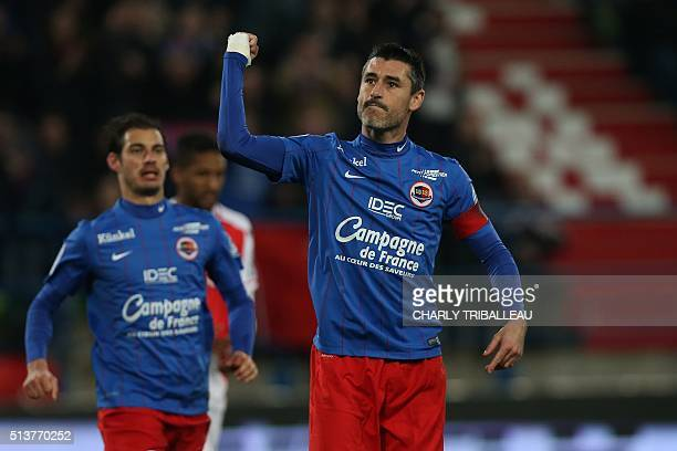 Caen's French midfielder Julien Feret celebrates after scoring a penalty kick during the French L1 football match between Caen and Monaco on March 4...