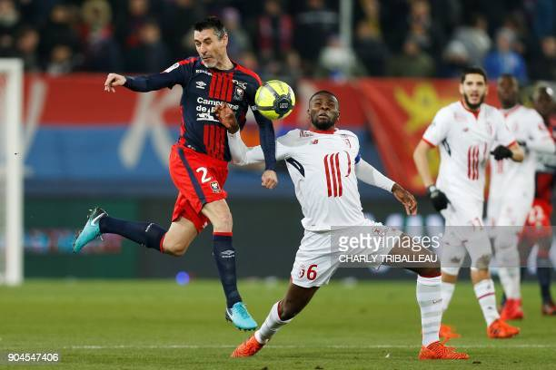 Caen's French midfielder Julien Feret vies with Lille's midfielder Ibrahim Amadou during the French L1 football match between Caen and Lille on...