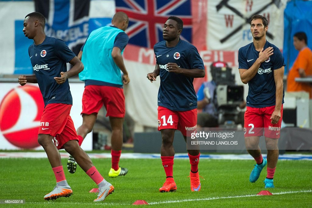 Caen's French midfielder Nicolas Seube (R) warm up before the French L1 football match Olympique de Marseille vs Stade Malherbe de Caen on August 8, 2015 at the Velodrome stadium in Marseille, southern France.