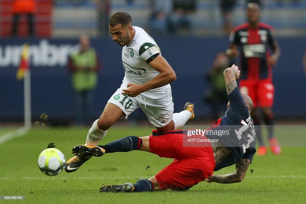 Caen's French midfielder Vincent Bessat (R) vies with Saint-Etienne's French forward Oussama Tannane (L) during the French L1 football match between Caen (SMC) and Saint-Etienne (ASSE) on August 12, 2017, at the Michel d'Ornano stadium, in Caen, northwestern France. /
