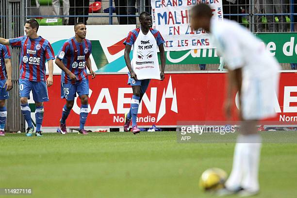 Caen's French striker M'Baye Niang celebrates with his teammates after scoring a goal after scoring a goal during the French L1 football match Caen...