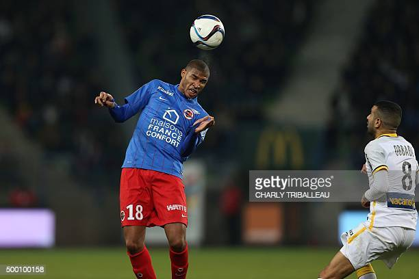 Caen's FrenchBeninese midfielder Jordan Adeoti heads the ball ahead of Lille's Moroccan midfielder Mounir Obbadi during the French L1 football match...