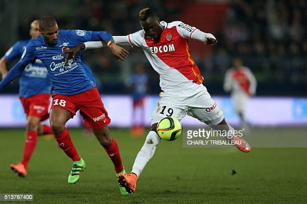 Caen's FrenchBeninese midfielder Jordan Adeoti vies with Monaco's Ivorian forward Lacina Traore during the French L1 football match between Caen and...