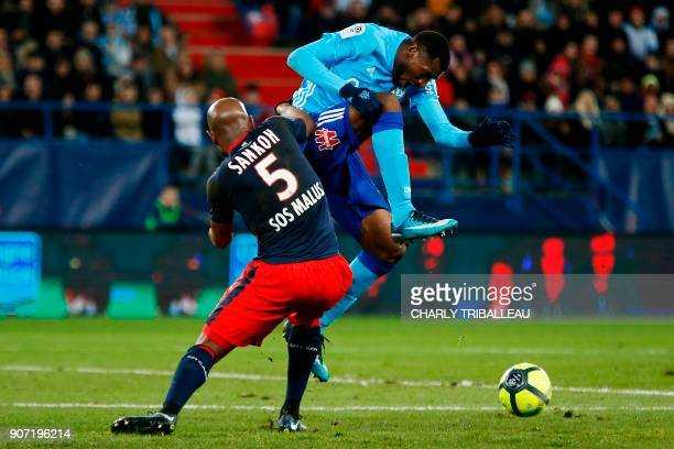 Caen's FrenchGuinean midfielder Baissama Sankoh vies for the ball with Olympique de Marseille's French midfielder AndreFrank Zambo Anguissa during...